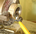 de-burring a bored hole using a de-burring tool on a mini-lathe